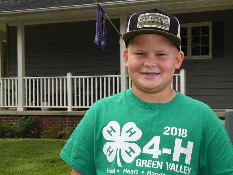 Brodie Yeager smiles outside his house
